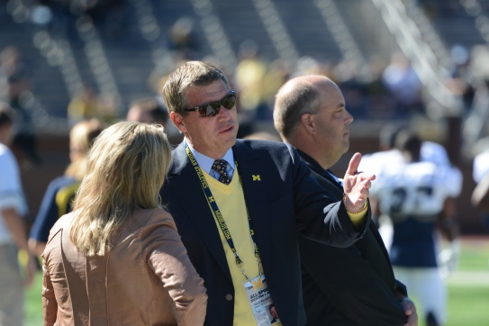 Michigan AD Dave Brandon (middle) has made some controversial decisions.
