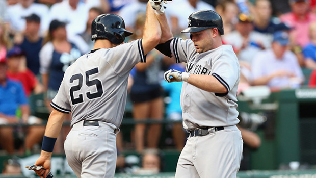 ARLINGTON, TX - JULY 30:  Brian McCann #34 of the New York Yankees (r) celebrates a two-run homerun with Mark Teixeira #25 in the third inning against the Texas Rangers at Globe Life Park in Arlington on July 30, 2015 in Arlington, Texas.  (Photo by Ronald Martinez/Getty Images)
