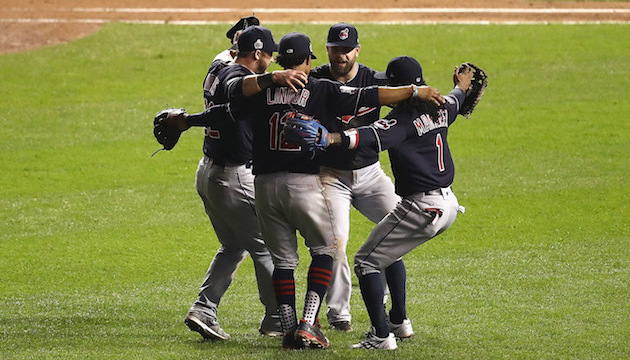 CHICAGO, IL - OCTOBER 28:  The Cleveland Indians celebrate after beating the Chicago Cubs 1-0 in Game Three of the 2016 World Series at Wrigley Field on October 28, 2016 in Chicago, Illinois.  (Photo by Elsa/Getty Images)