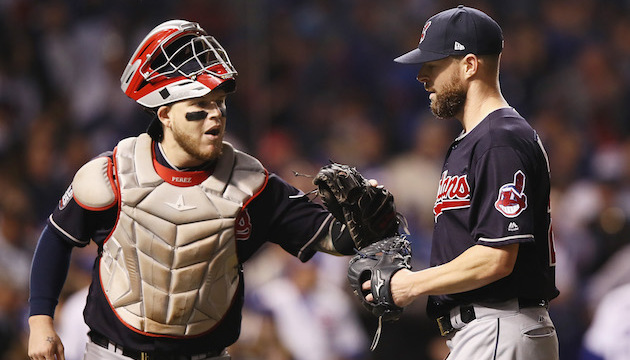 CHICAGO, IL - OCTOBER 29:  Roberto Perez #55 of the Cleveland Indians congratulates Corey Kluber #28 at the end of the first inning against the Chicago Cubs in Game Four of the 2016 World Series at Wrigley Field on October 29, 2016 in Chicago, Illinois.  (Photo by Ezra Shaw/Getty Images)